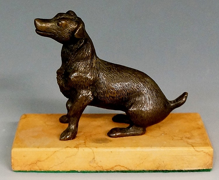 A 19th Century bronze model of a dog on rectangular sienna marble plinth, 7