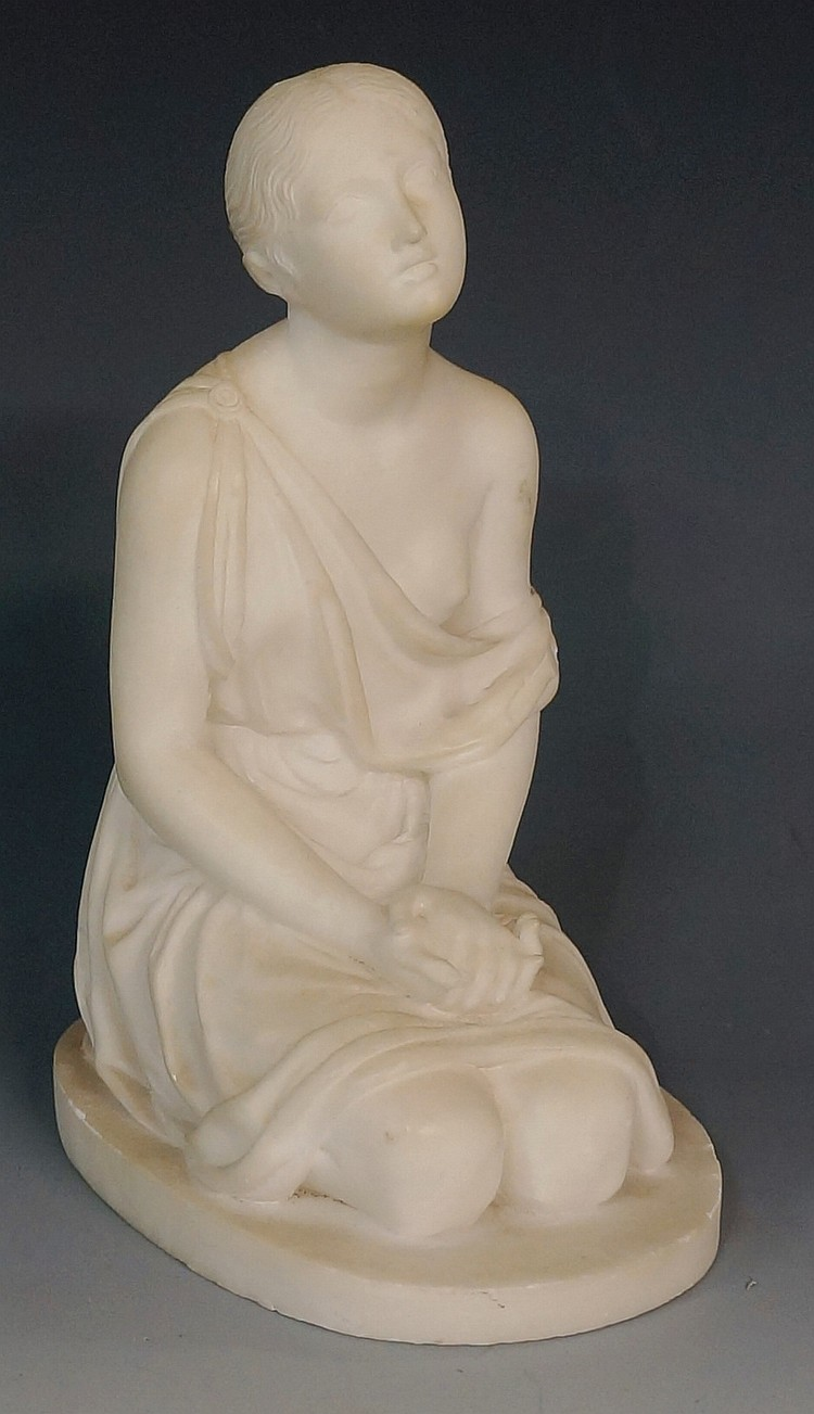 A 19th Century white marble carving of a kneeling young woman, her hands cl