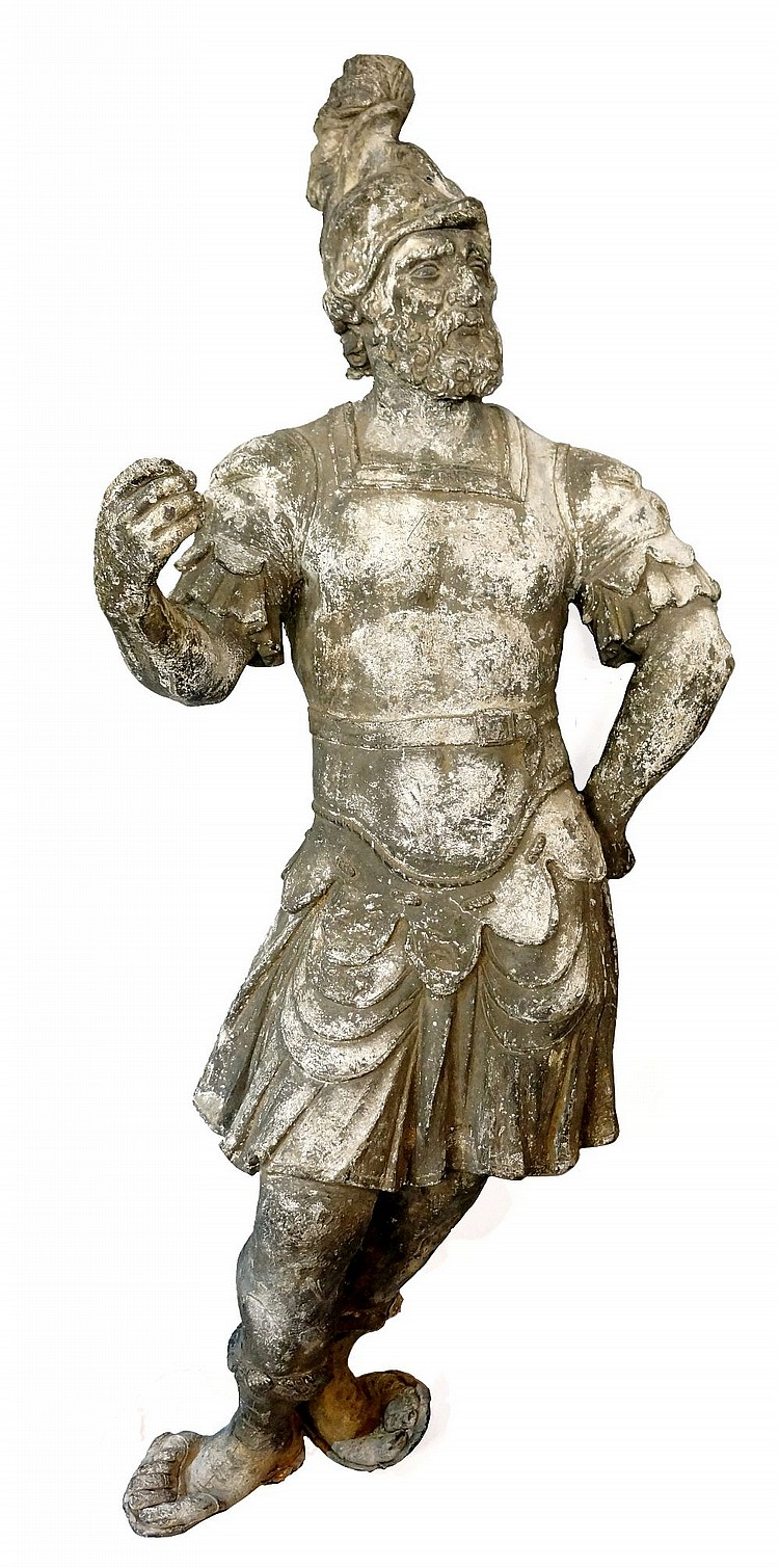 A near life size lead statue of a Roman Centurion soldier wearing plumed he