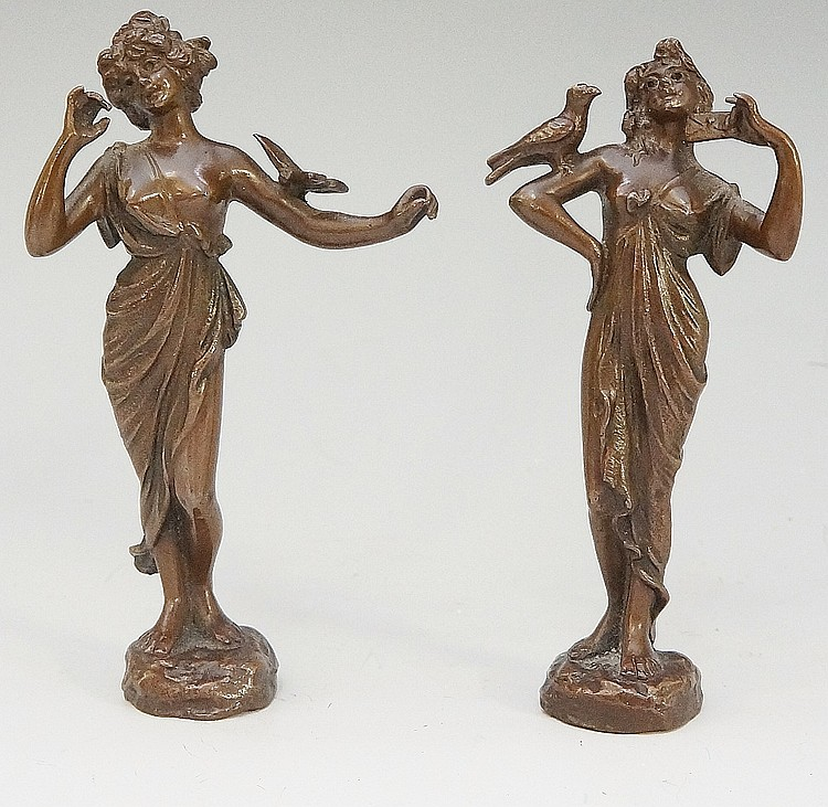 A fine pair of miniature bronze figures of lightly draped young women, one