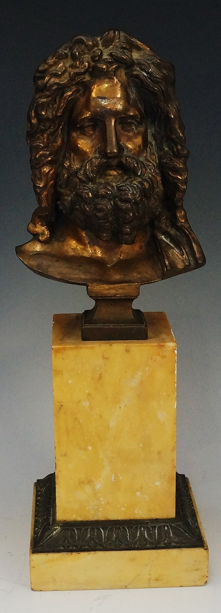 An early 19th Century head and should gilt bronze bust of a bearded man on