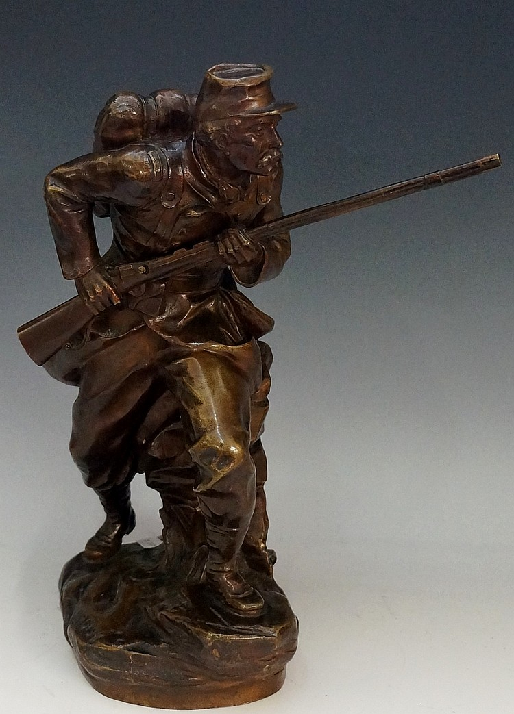 Aristide Croisy (1840-1899) - a French bronze figure of a soldier carrying