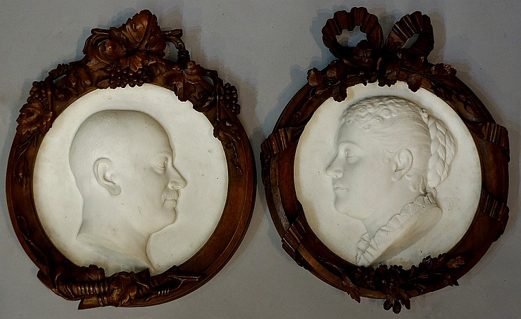 Charles Henri Joseph Cordier - a pair of white marble roundels finely carve