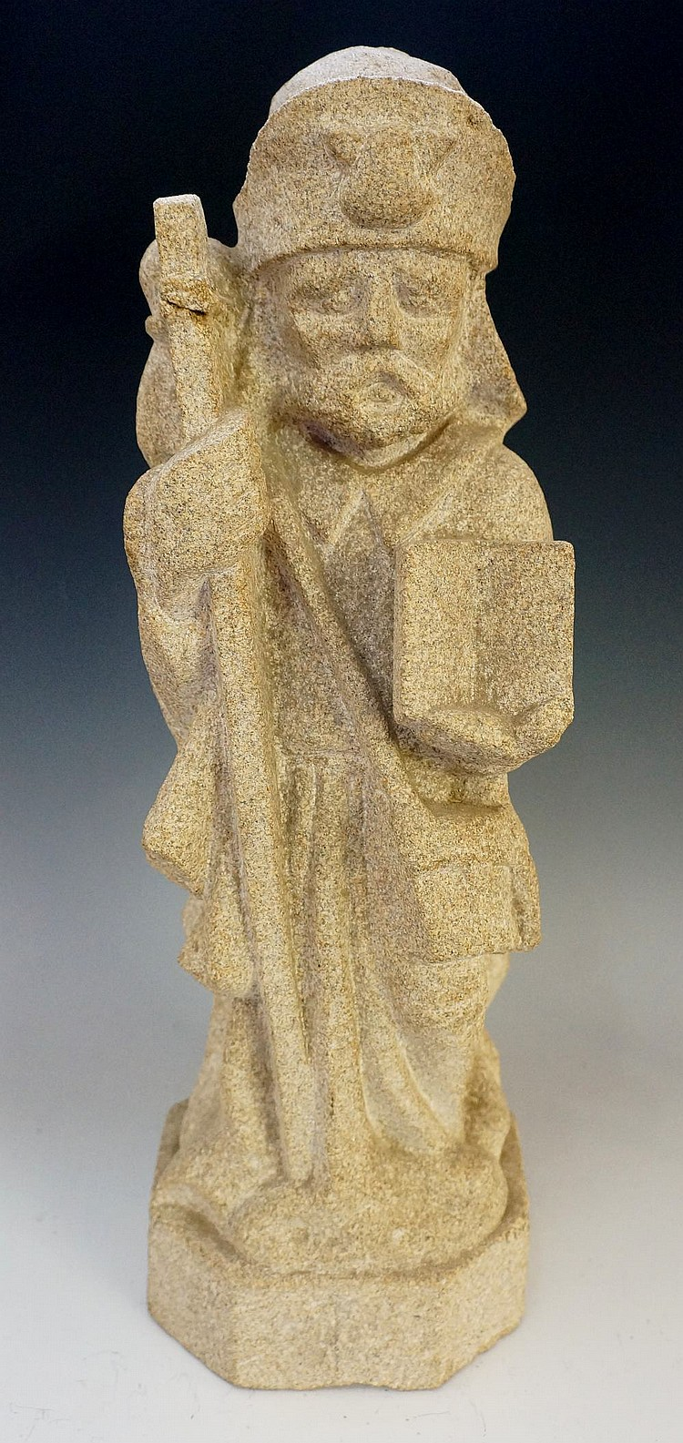 A carved stone figure of a saint, 48cm high, 20th Century