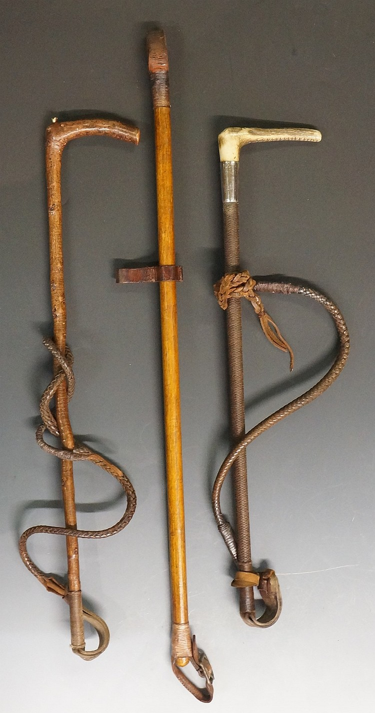 A selection of two hunting whips, one antler handled by Swaine and Adeney,