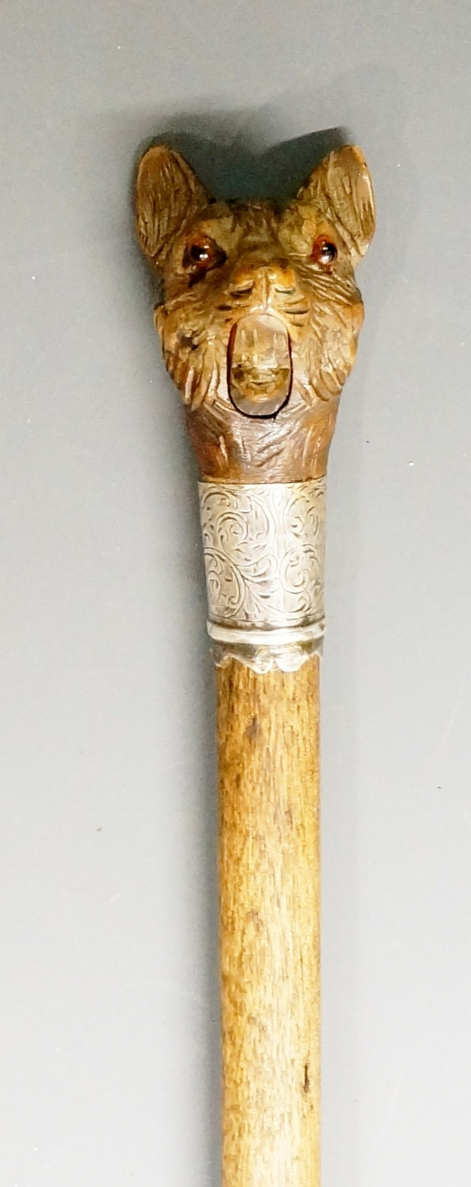 A late Victorian walking stick, the automaton Black Forest handle carved as