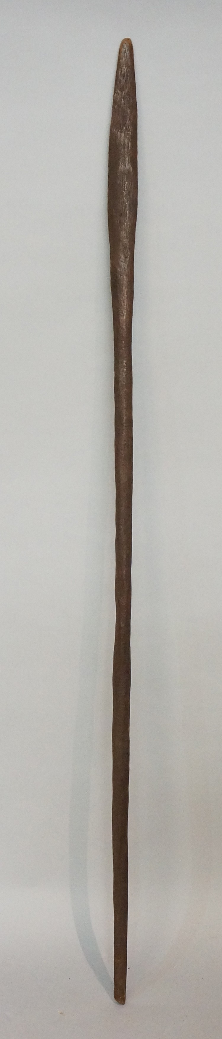 An Aboriginal club of tapered form, 140cm long