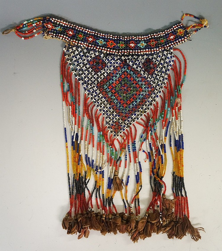A small African tribal beadwork apron, with cotton tasselled terminals, 30c