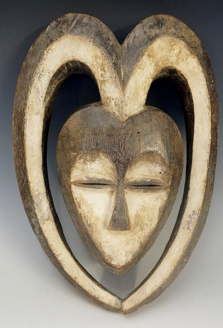 An African tribal mask with applied white pigment decoration, 36cm high