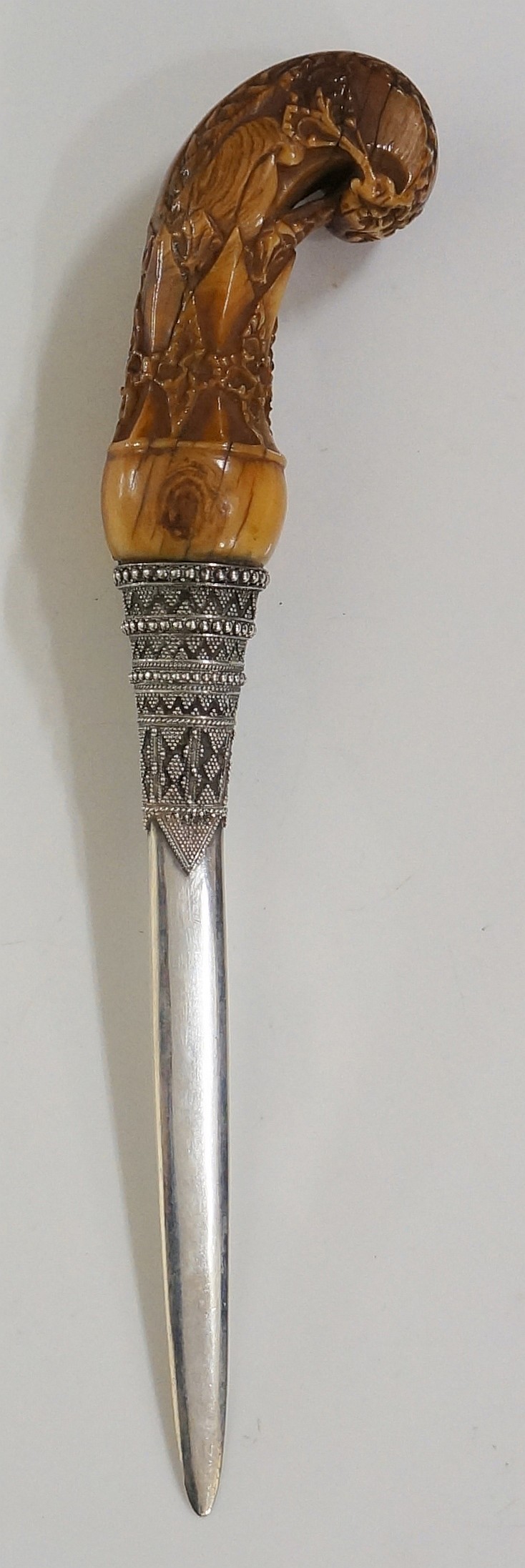 An ivory Kris dagger, the handle carved with foliage and floral bands, repl