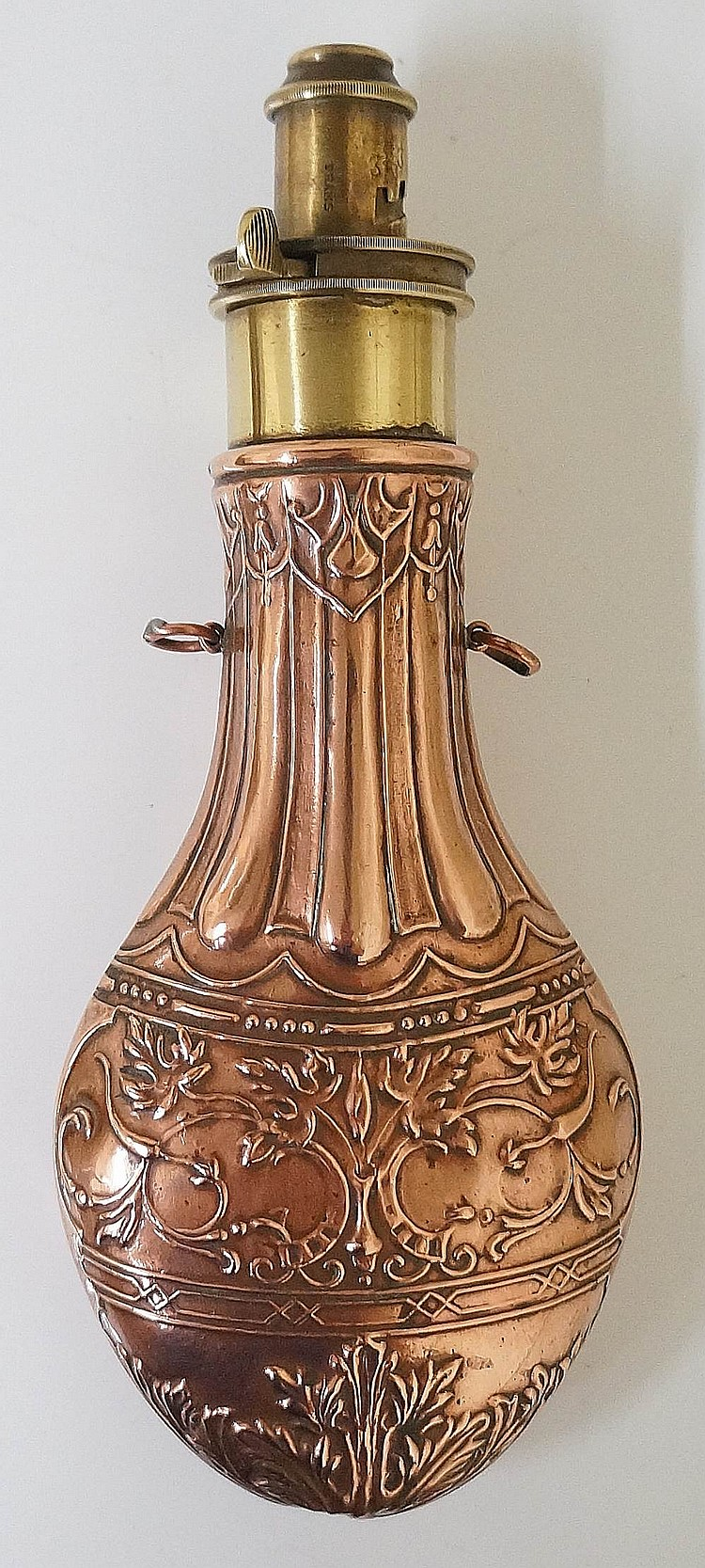 A 19th Century copper and brass shot flask with four position spout, the fl