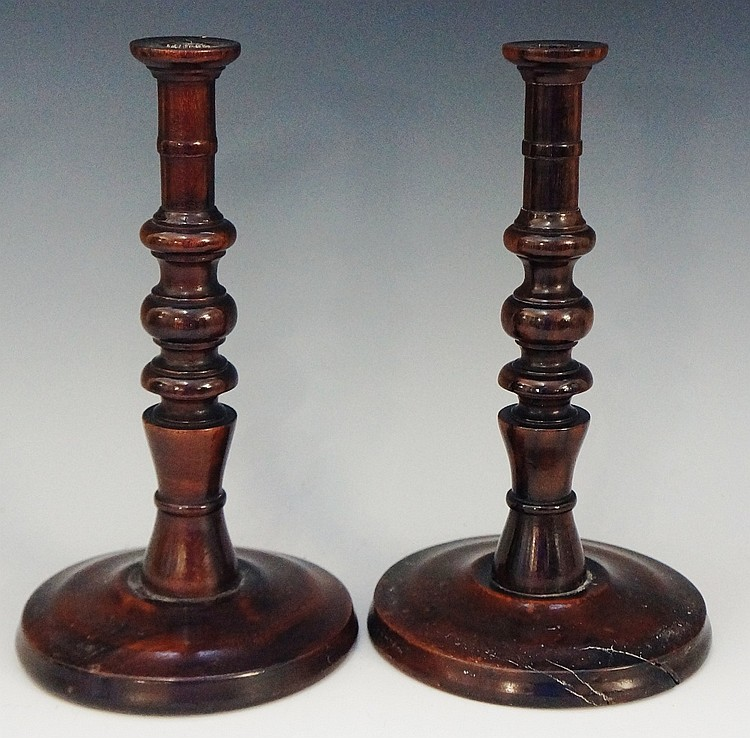 Treen - a pair of 18th Century rosewood candlesticks with tall cylindrical