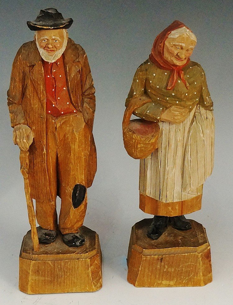 Black Forest - two Black Forest polychrome decorated figures of an elderly