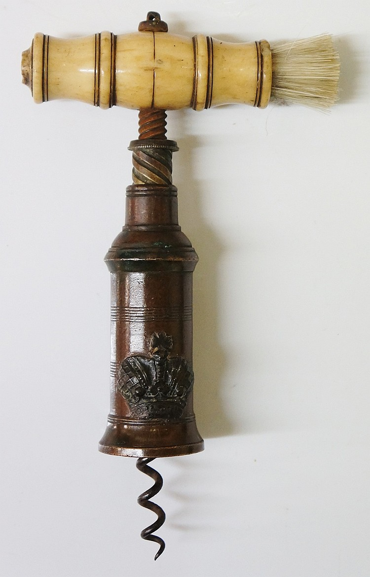 A 19th Century double action bronze corkscrew with applied crown, ivory han