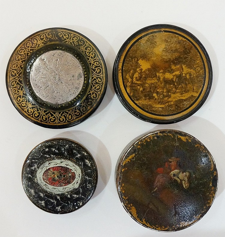 An early 19th Century black papier maché circular snuff box, the lid transf