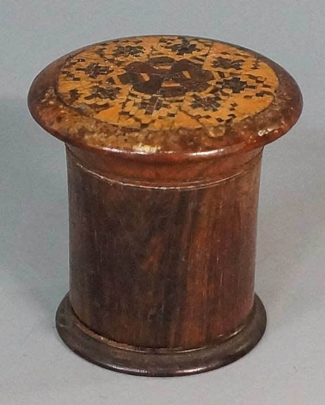 A Victorian Tunbridge ware nutmeg grater of cylindrical design with flared