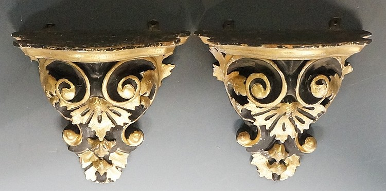 A pair of scroll, shell and foliate carved wall brackets, gilt and black, 2