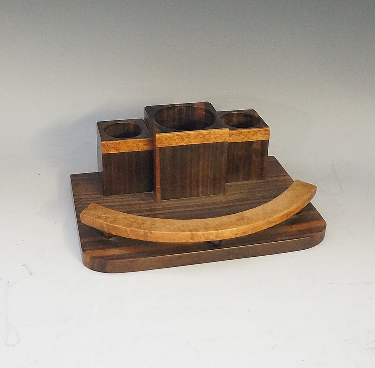 A Macassar ebony and burr amboyna veneered desk tidy of Art Deco design wit