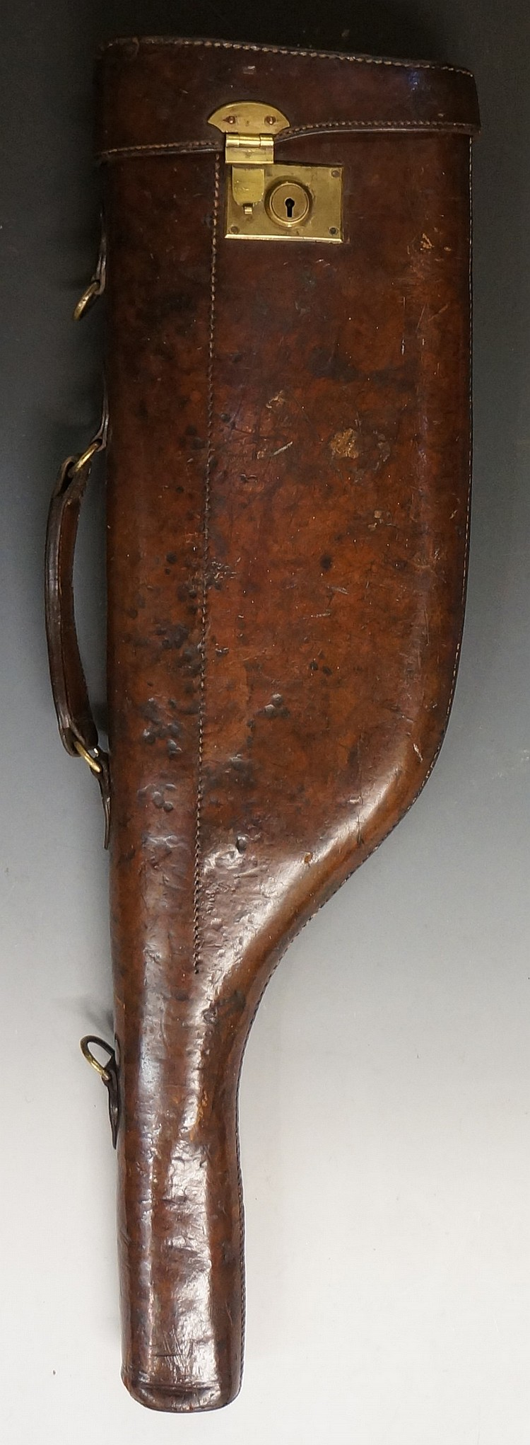A 19th Century 'leg-o-mutton' brown leather gun case with brass lock and fi