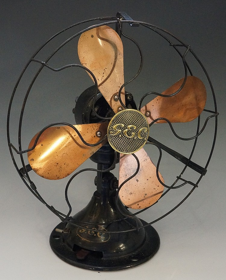 A GEC War Finish desk fan with coppered blades and black lacquer frame cent
