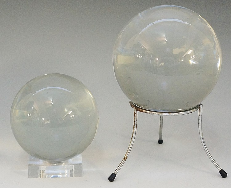 A 10cm diameter crystal ball on a modern stand; an 8cm diameter crystal bal