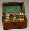 A late 19th Century French scent flask casket, the amboyna case of canted r