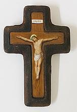 A continental porcelain crucifix transfer printed and painted with figure o