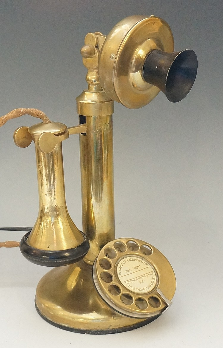 A vintage brass telephone, 28cm high