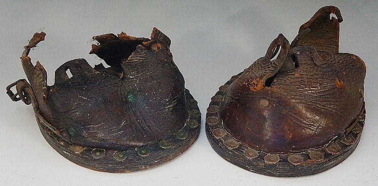 A pair of late 19th Century leather hoof boots or lawn boots, thick leather