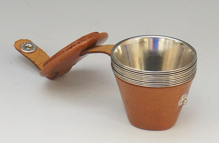 A set of ten steel hunting stirrup cups, the numbers 1 to 10 stamped to the