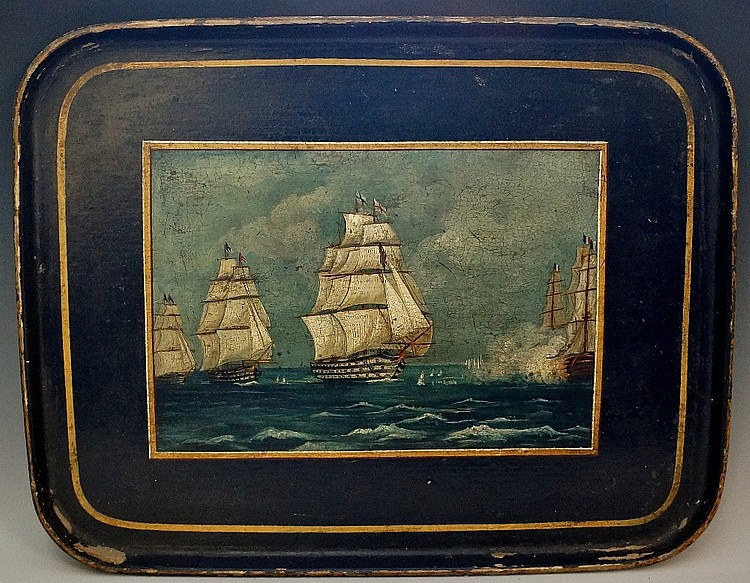 A Victorian rounded rectangular black papier maché tray painted to the cent
