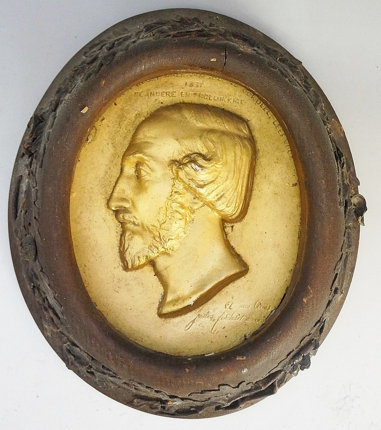 A 19th Century German gold painted plaster plaque relief moulded with head