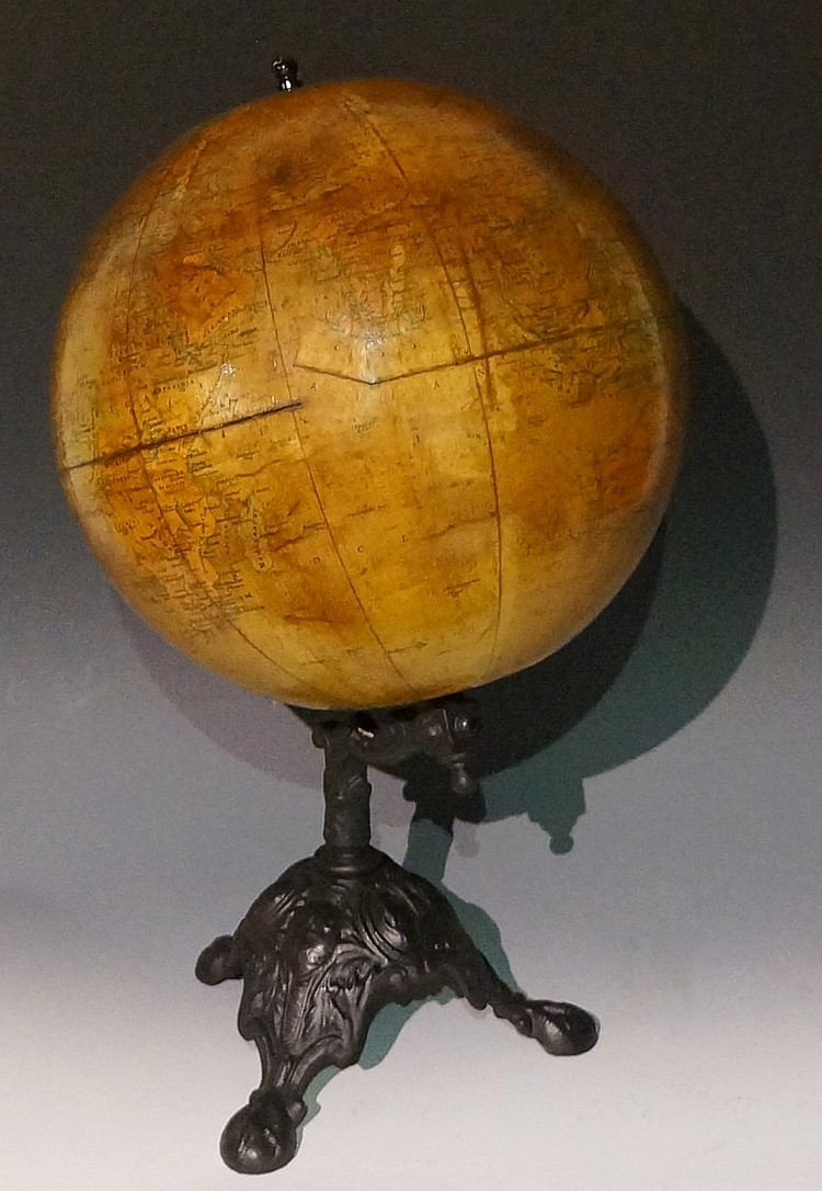 A. Brown & Sons Limited - a 12 inch terrestrial globe, on a black cast iron