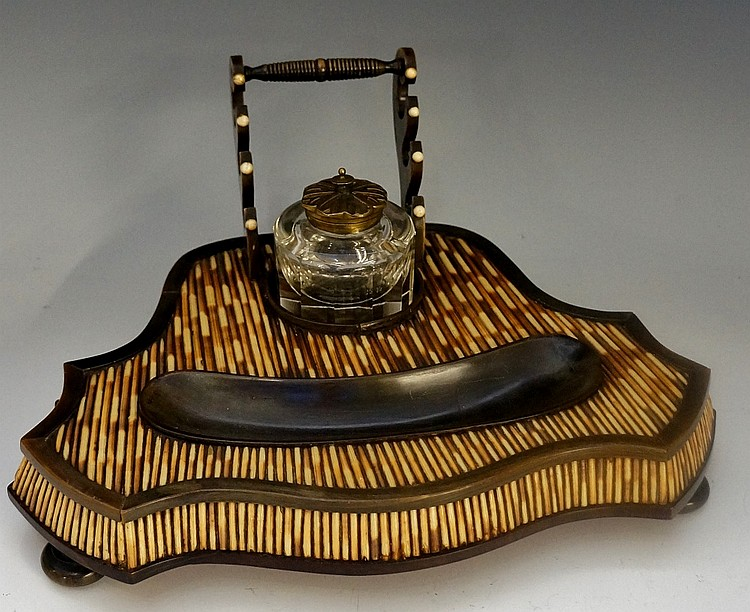 A mid 19th Century porcupine quill and horn inkstand of shield shape, the f