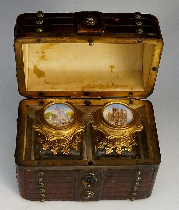 A 19th Century novelty leather box in the form of a domed travelling trunk,