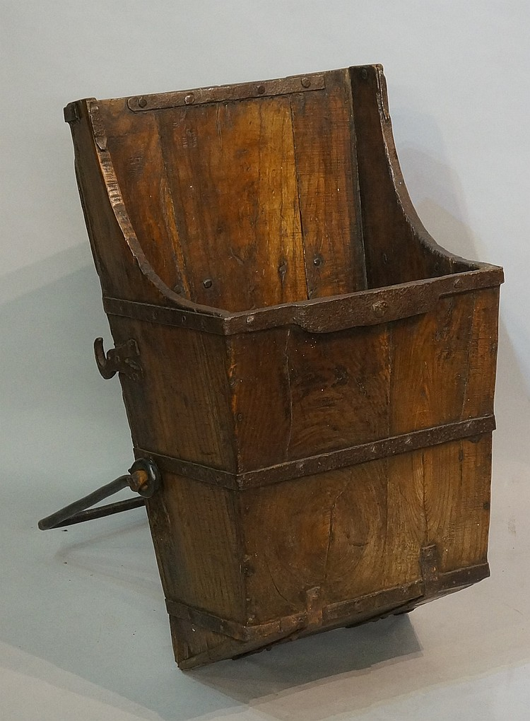 A 19th Century tapered elm grain carrier, the body with wrought iron bands