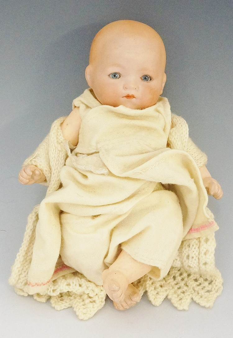 A small Armand Marseille porcelain headed doll with closing eyes, composite