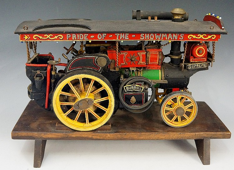A hand built model of a traction engine - Burrell Supreme with red and gree