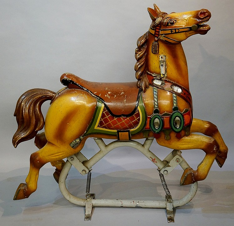 A continental carved wood fairground horse, polychrome decorated and applie