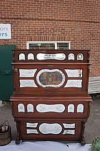 A late 19th / early 20th Century coin-in-the-slot barrel organ, contained w