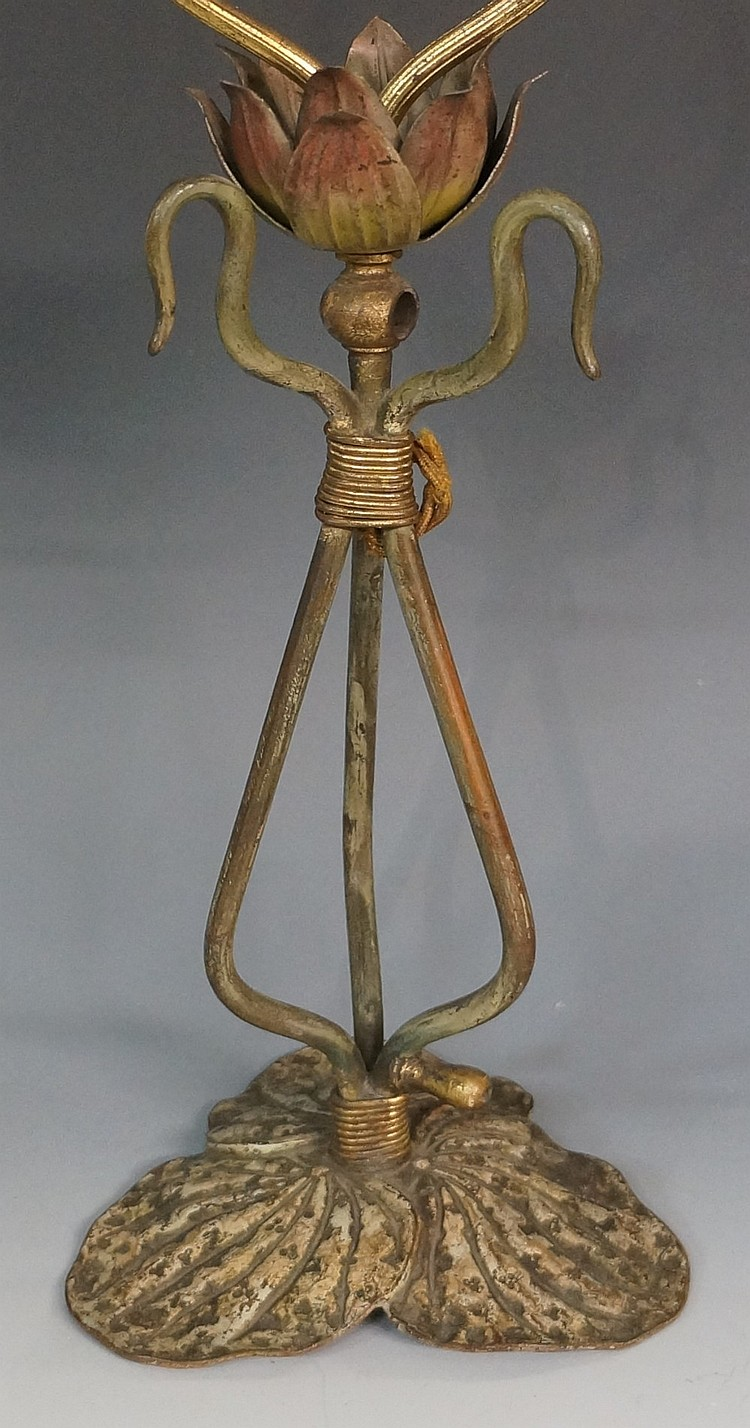 An Art Nouveau cold painted bronze lamp with three scrolling branches termi