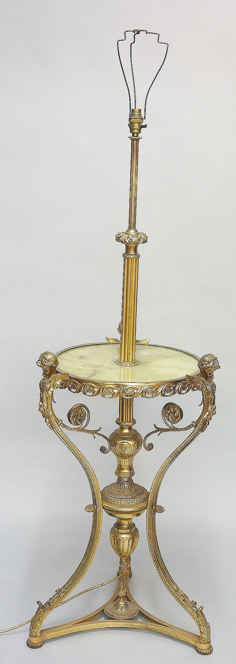 A gilt metal and green onyx standard lamp, the fluted stem with foliate col