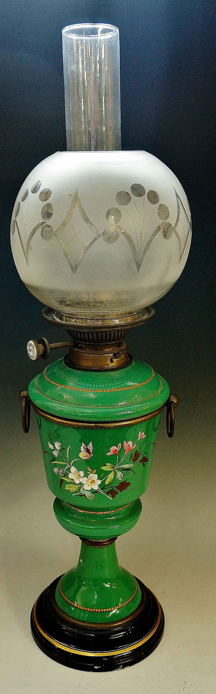 A Victorian opaque green glass oil lamp, the slightly tapered cylindrical b
