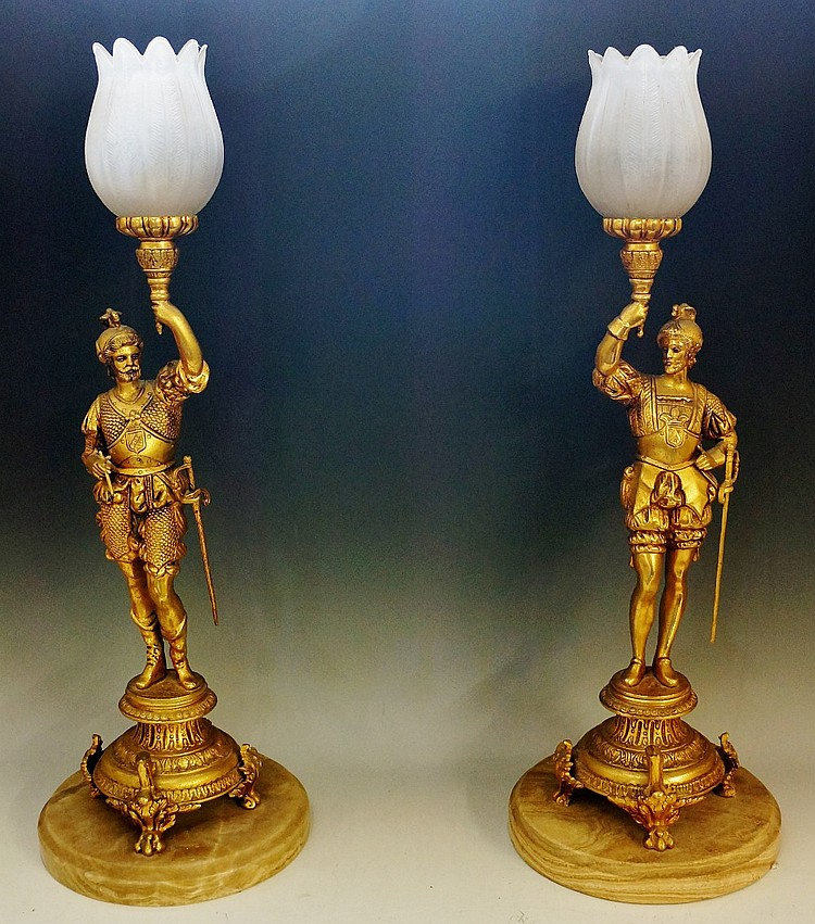 Meubles Francais (Reproductions) Ltd - a pair of gilt metal lamps modelled