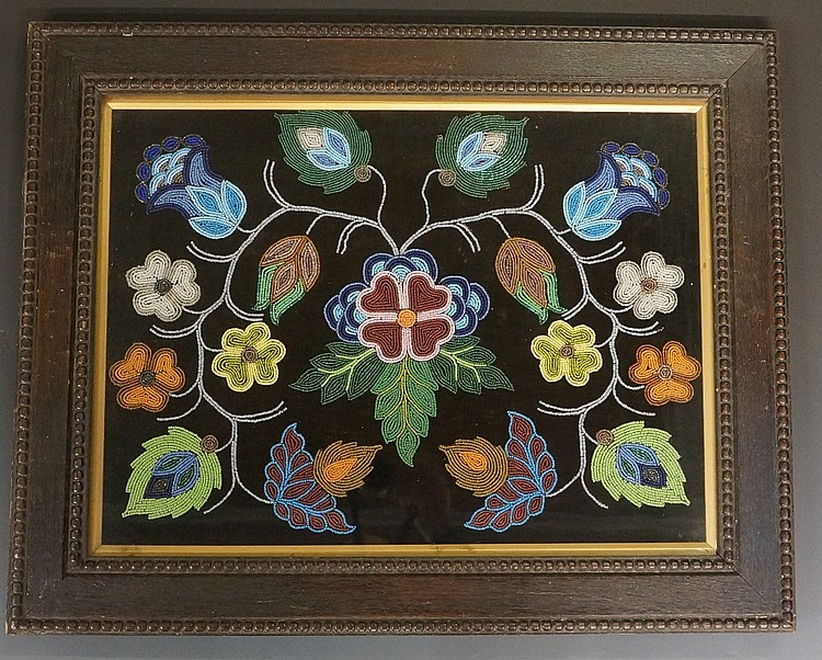 A colourful Victorian beadwork panel, the black ground worked with flowerhe