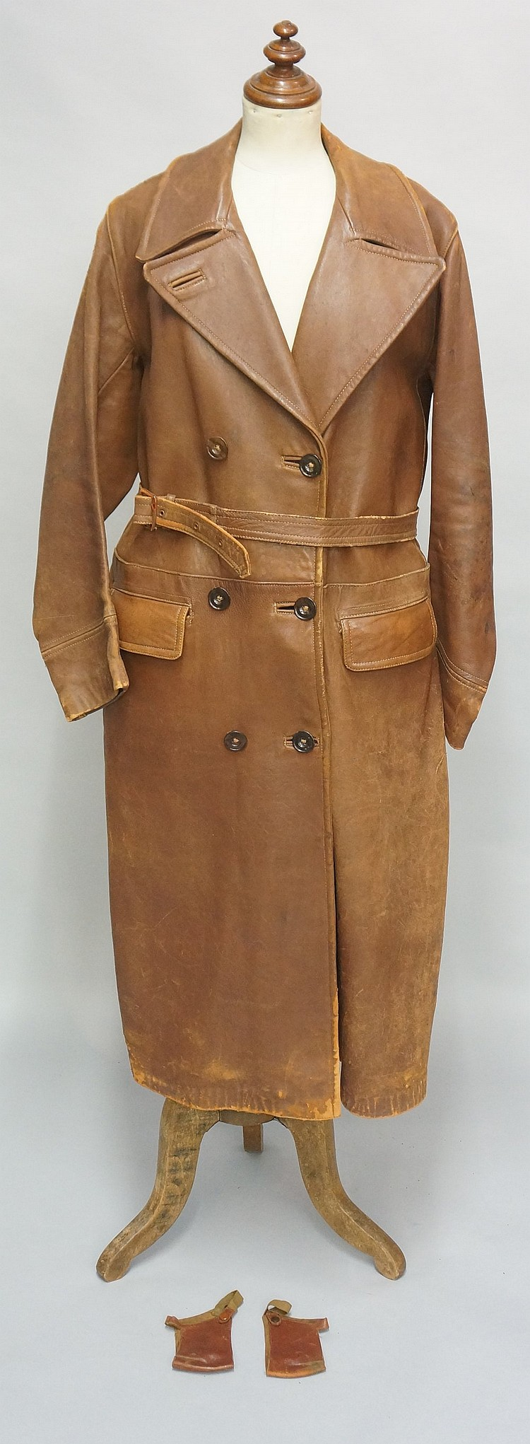 A ladies brown leather driving coat with lined interior; together with a pa