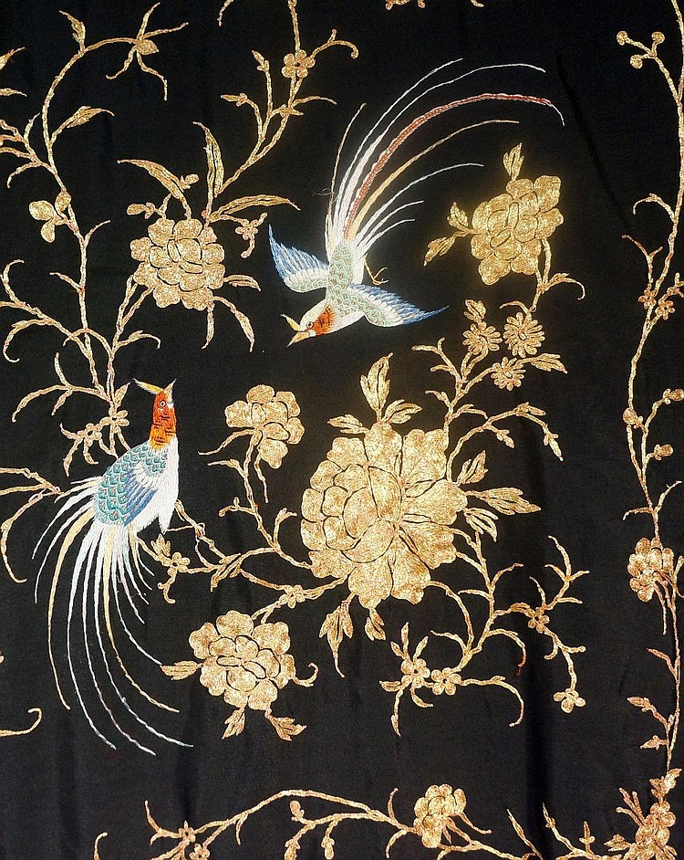 A fine quality black silk shawl finely worked in coloured silks and gold th
