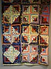 An early to mid 20th Century log cabin patchwork quilt made up of ten by te