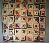 An early to mid 20th Century log cabin patchwork quilt made up of seven by