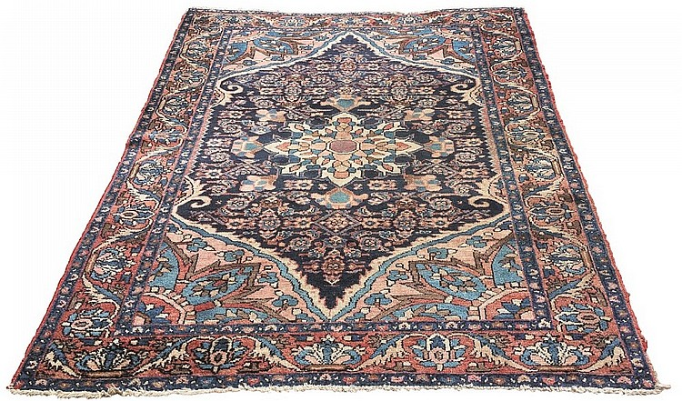 A Persian Malayer rug, central blue, cream and rust coloured floral medalli